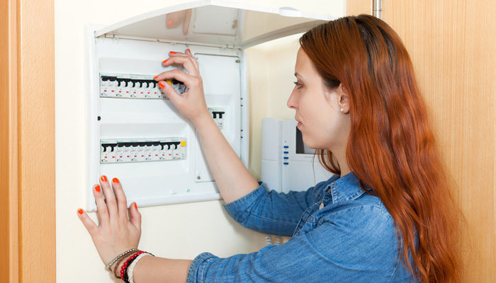 woman turning the switch off