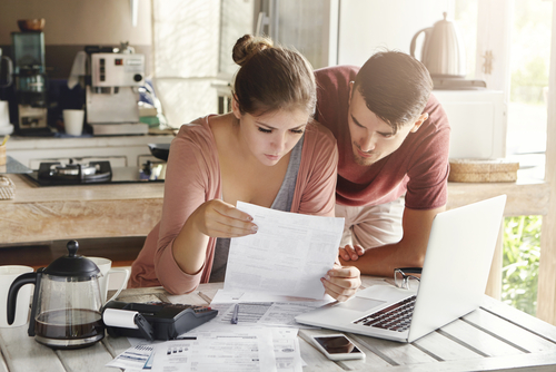 Couple looking at bills together